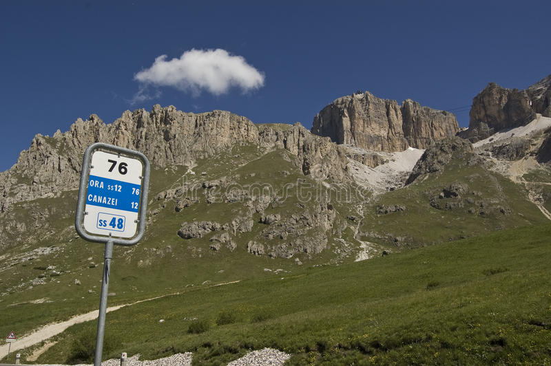 Km 76. Road signal on the dolomites chain, italian alps stock photo