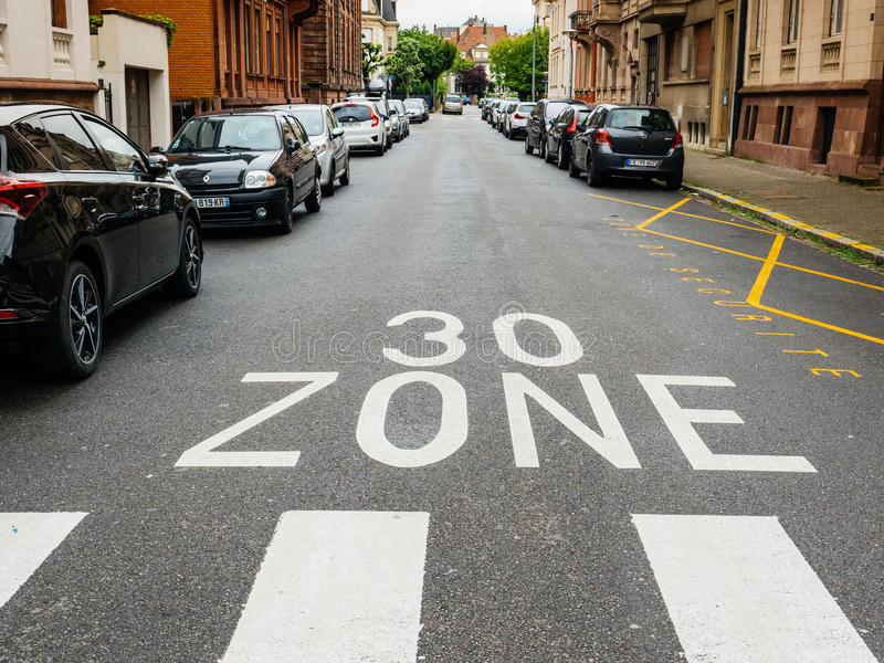 30 km zone pov personal perspective French city street car parking. STRASBOURG, FRANCE - MAY 7, 2017: 30 Km Zone in calm neighborhood in European City with stock photos