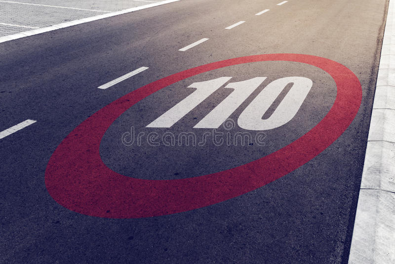 110 kmph or mph driving speed limit sign on highway stock image