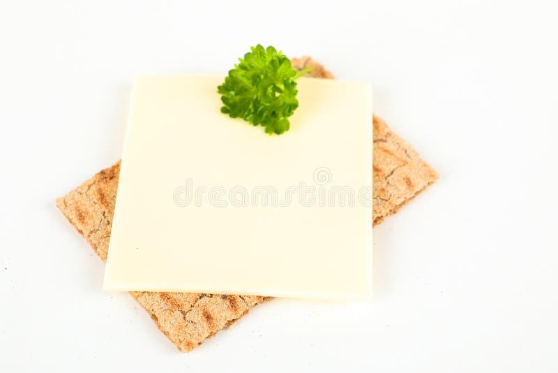 Knäckebröd med ost royaltyfria bilder