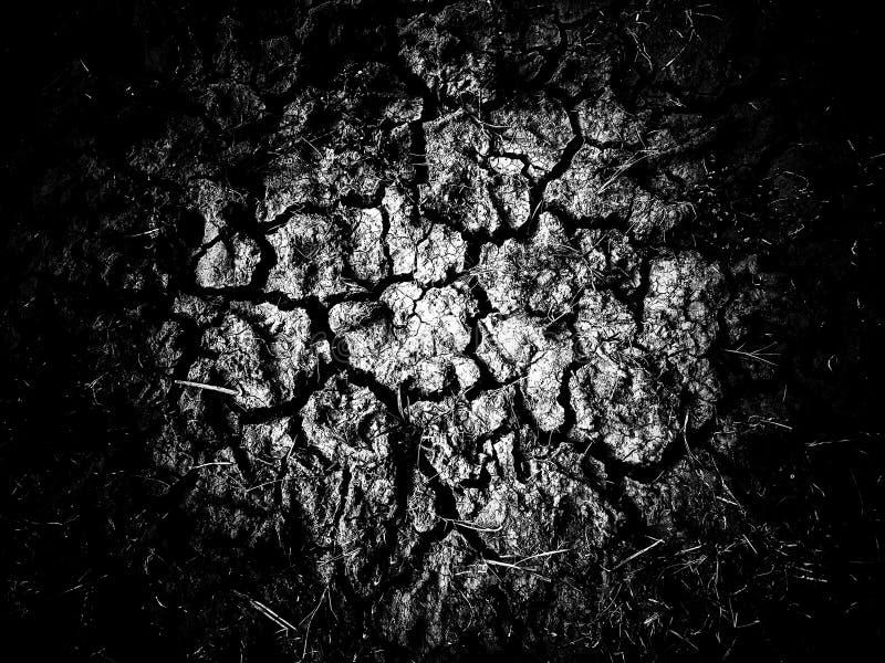 Knäckt jord, scorsched jordjordningsgyttja med sprickatextur royaltyfria foton