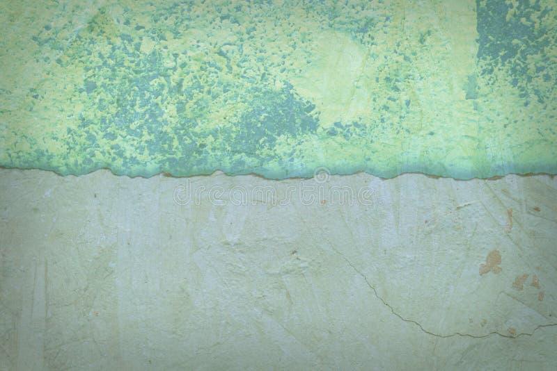 Knäckt murbruk för tappning gräsplan royaltyfri bild