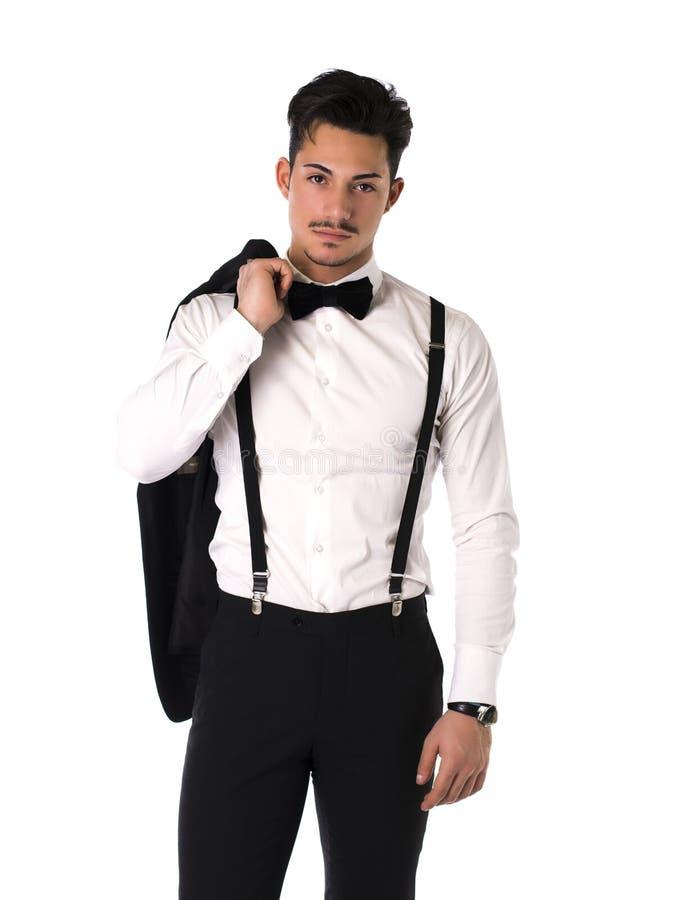 Knappe elegante jonge mens met kostuum, vlinderdas en snor stock foto's
