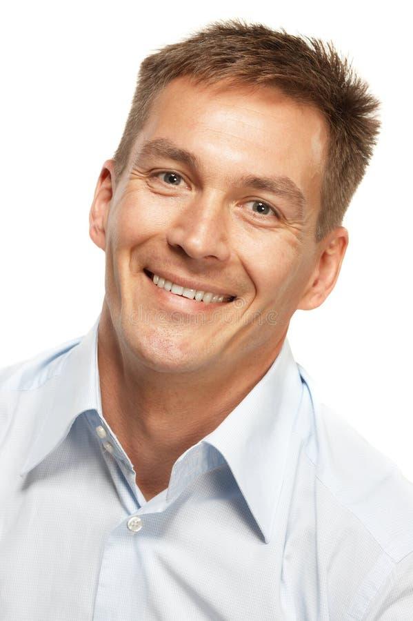 Knappe glimlachende mens stock afbeelding