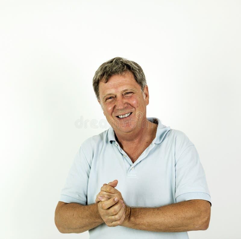 Knappe glimlachende mens in het blauwe overhemd van het vrije tijdspolo royalty-vrije stock foto's