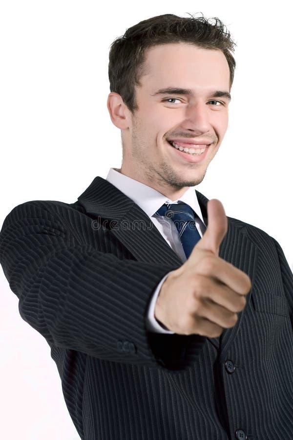 Knappe glimlachende zakenlieden die in orde zeggen stock foto