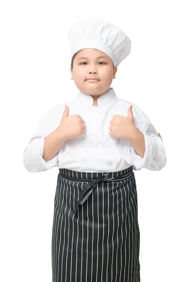Knappe jong geitje Spaanse chef-kok die de duimen opgeven royalty-vrije stock foto
