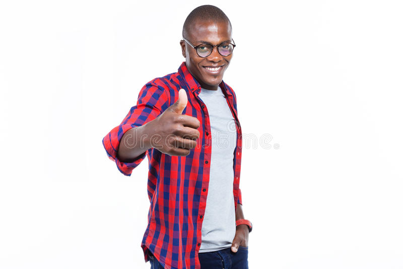 Knappe jonge mens die geluk met duim omhoog over witte achtergrond uitdrukken stock fotografie