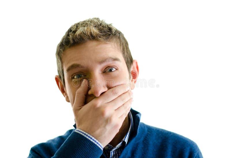 Knappe jonge mens die mond behandelen met hand royalty-vrije stock fotografie