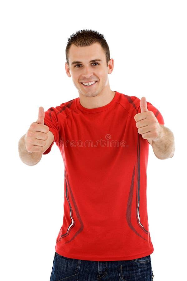 Knappe jonge mens met omhoog duimen stock foto's