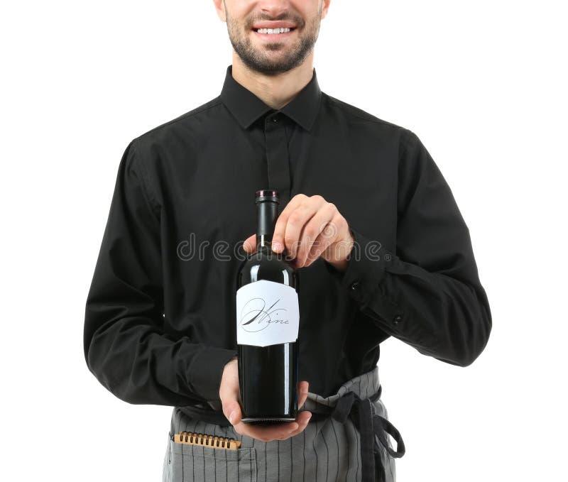 Knappe kelner met fles wijn op witte achtergrond stock foto's