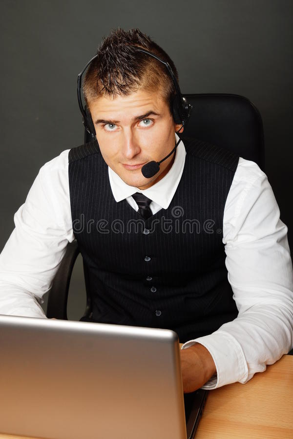 Knappe klantenexploitant stock afbeelding