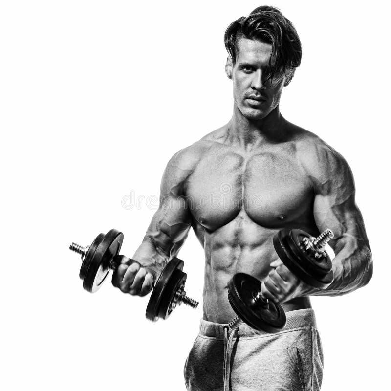 Knappe machts atletische mens in opleiding omhoog pompend spieren met stock afbeeldingen
