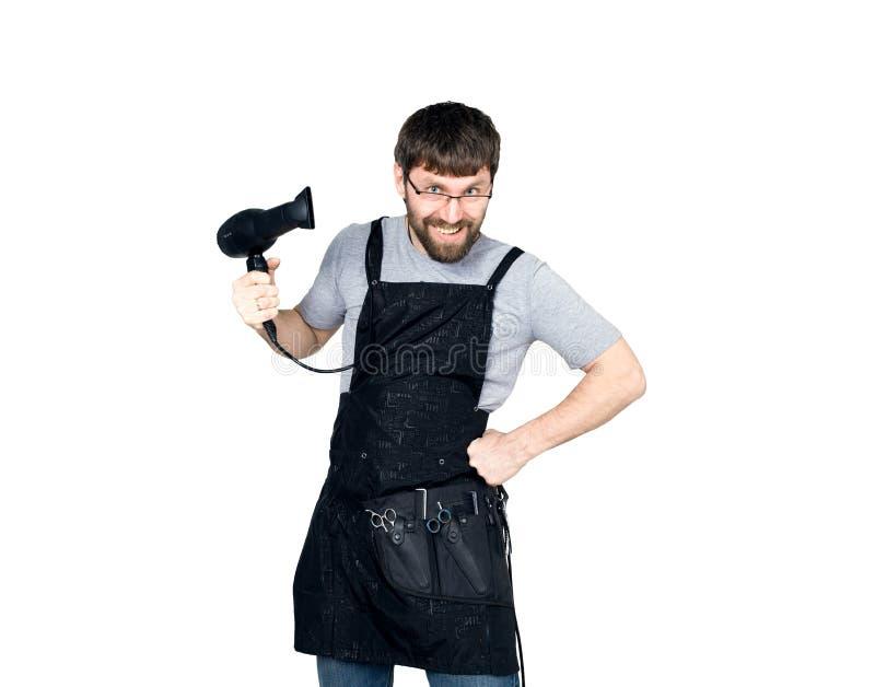 Knappe Mannelijke kapper die een hairdryer houden en voor de camera stellen Geïsoleerdj op witte achtergrond royalty-vrije stock foto