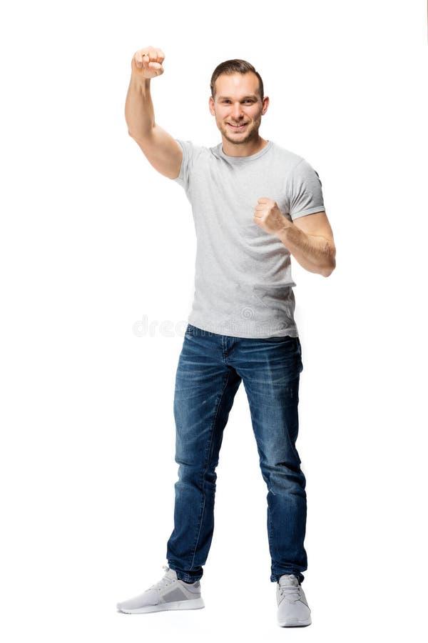 Knappe mens die zijn vuisten dichtklemmen Het toejuichen van gebaar royalty-vrije stock foto's