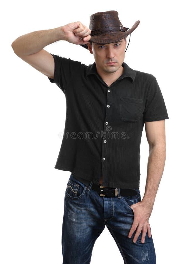 Knappe mens in een cowboyhoed royalty-vrije stock foto