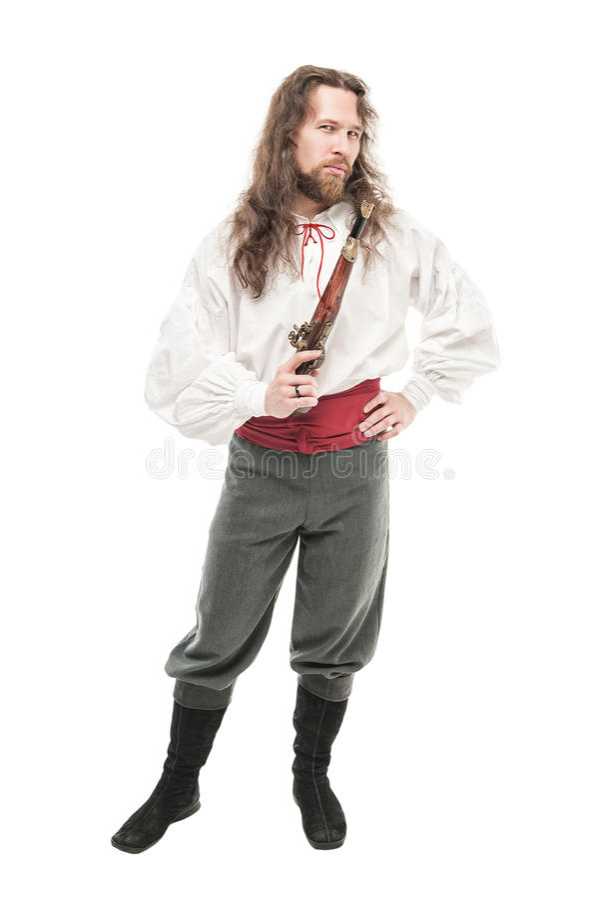 Knappe mens in historisch geïsoleerde piraatkostuum met pistool royalty-vrije stock afbeeldingen