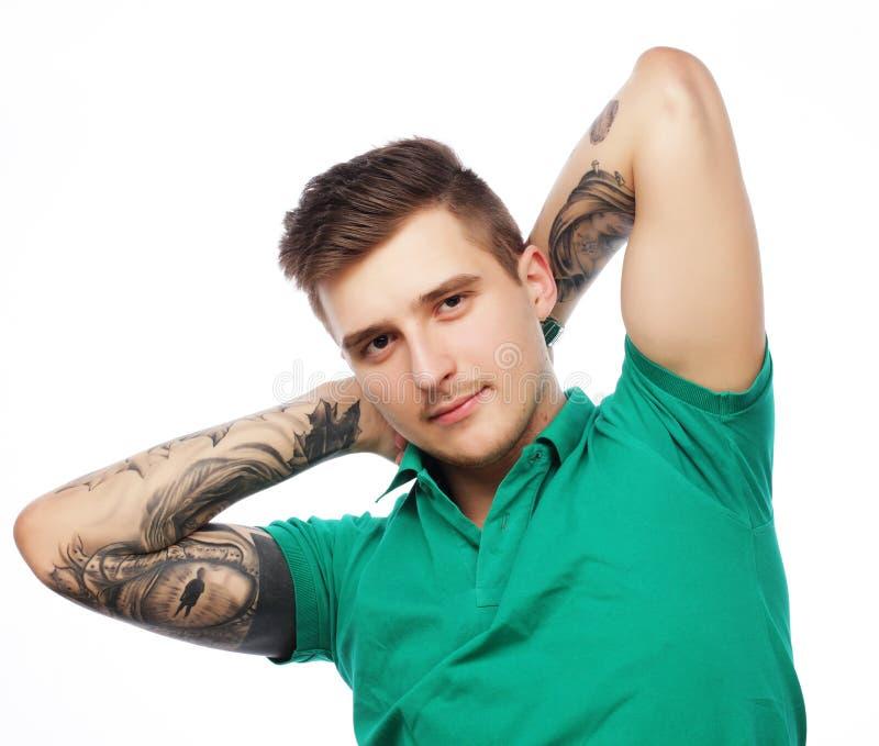 Knappe mens in lege groene t-shirt royalty-vrije stock afbeeldingen