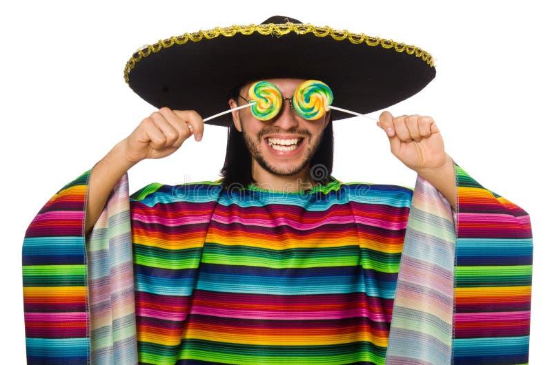 Knappe mens in levendige ponchoholding lollypop stock afbeeldingen