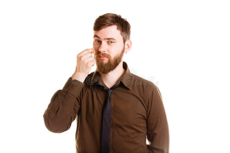 Knappe mens met en baard stellen die geïsoleerd op een witte achtergrond bevinden zich stock fotografie