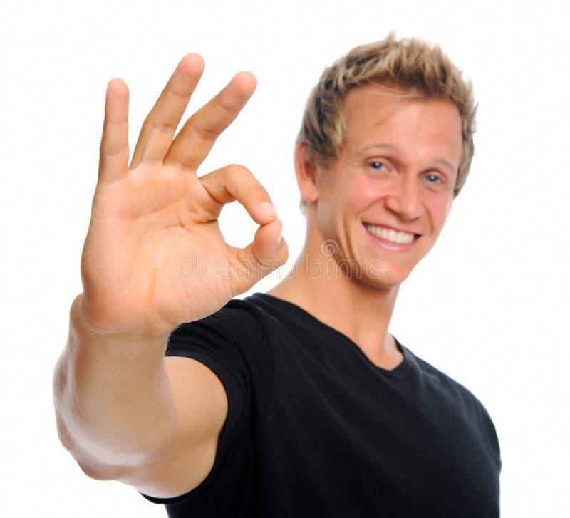 Knappe mens met O.K. teken royalty-vrije stock afbeelding