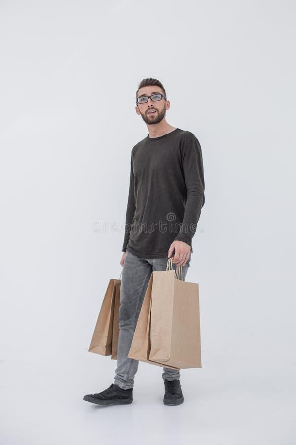 Knappe mens met zak Geïsoleerd over witte achtergrond stock afbeeldingen