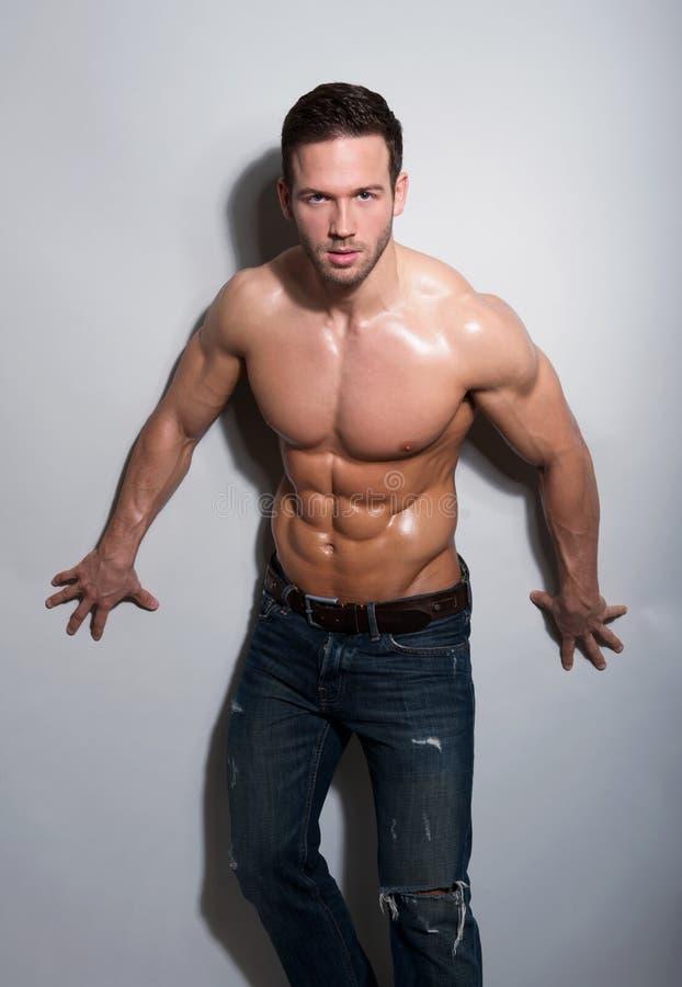 Knappe sexy jonge mens royalty-vrije stock afbeelding