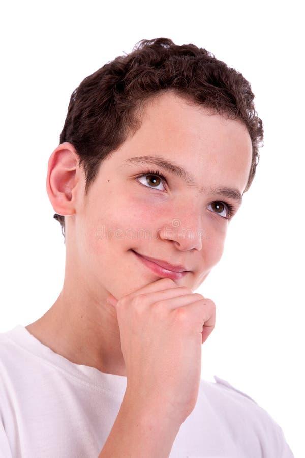 Knappe tiener, het denken stock afbeeldingen