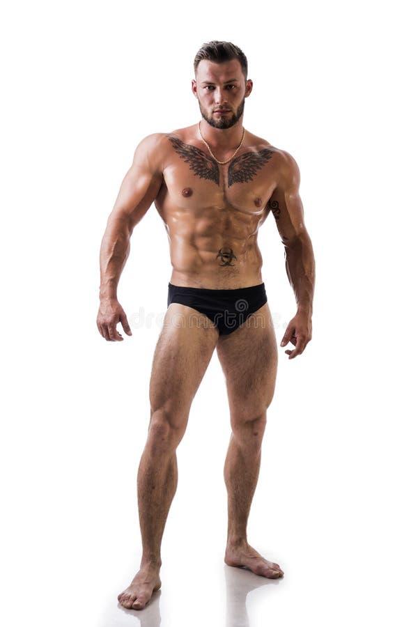 Knappe topless spiermens geïsoleerde status, stock afbeelding