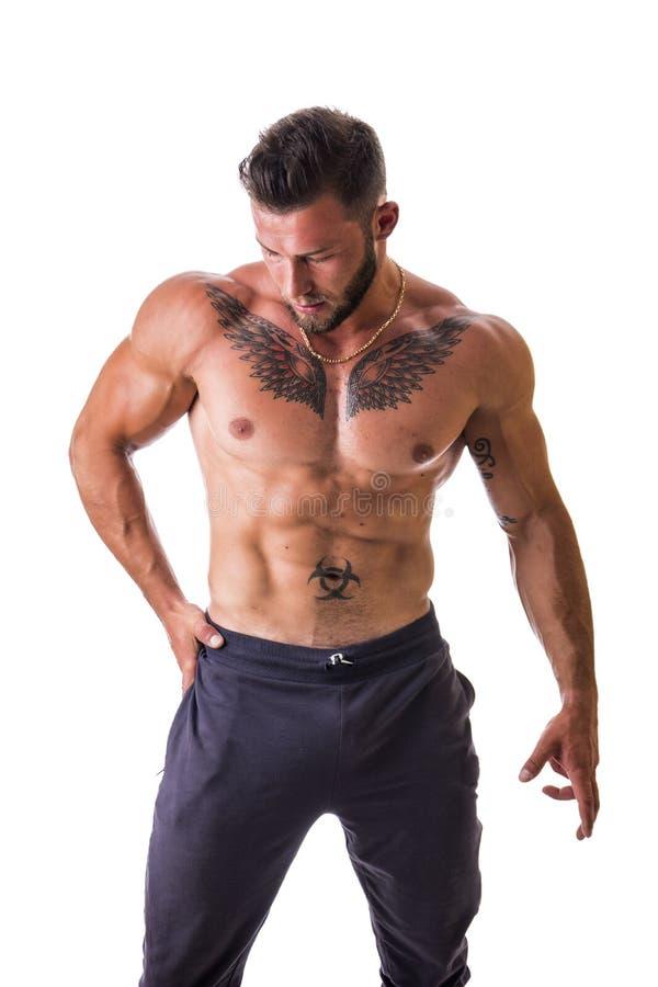 Knappe topless spiermens geïsoleerde status, stock foto's