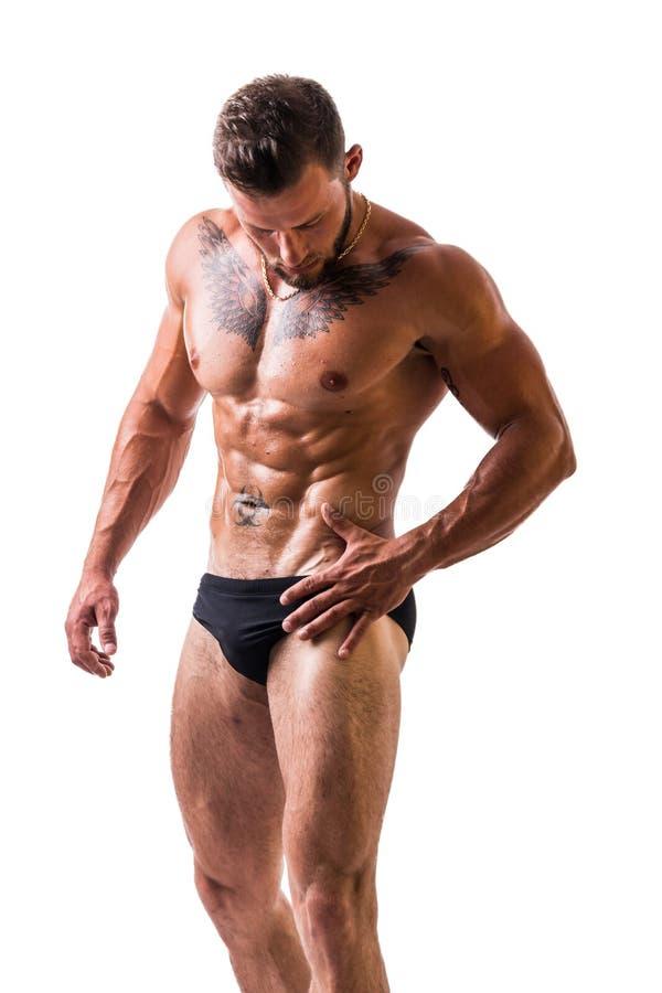 Knappe topless spiermens status stock foto's