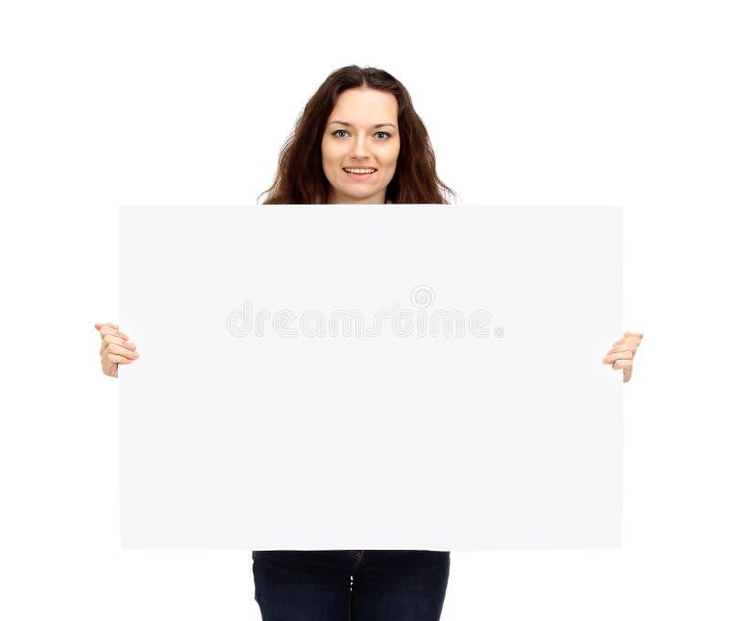 Knappe zakenman die een grote affiche voor de reclame van tekens houden royalty-vrije stock foto's