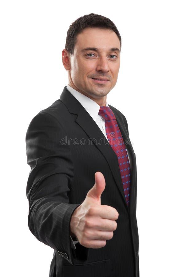 Knappe zakenman die zijn duim tonen stock foto