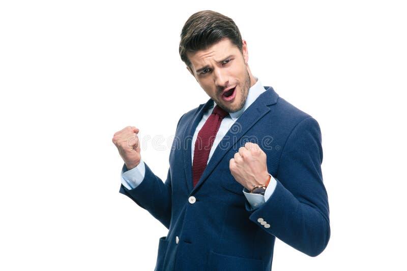 Knappe zakenman die zijn succes vieren stock afbeeldingen