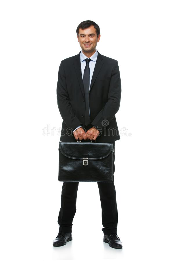 Knappe zakenman in kostuum met aktentas royalty-vrije stock foto