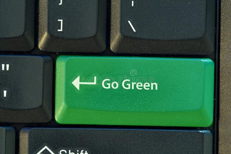 knappen går green royaltyfria bilder