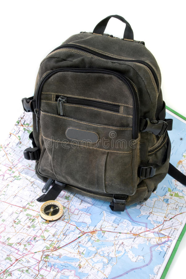 Knapsack. With map against white background royalty free stock photos
