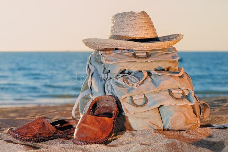 Knapsack and sandal. Knapsack, hat and sandal on the sandy beach stock photos