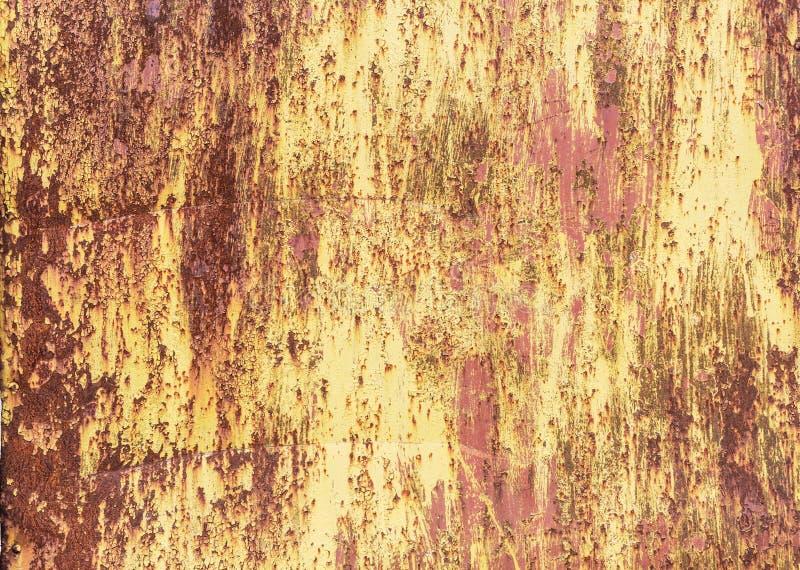 Knastra av målarfärg på en metallbakgrund arkivbilder