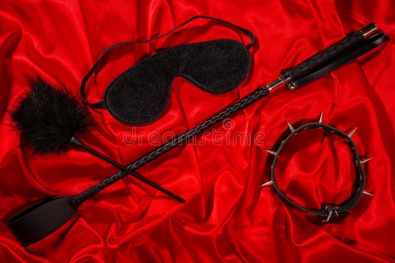 Knechtschaft, verworrene erwachsene Sexspiele, Schleife und BDSM-Lebensstilkonzept stockfoto