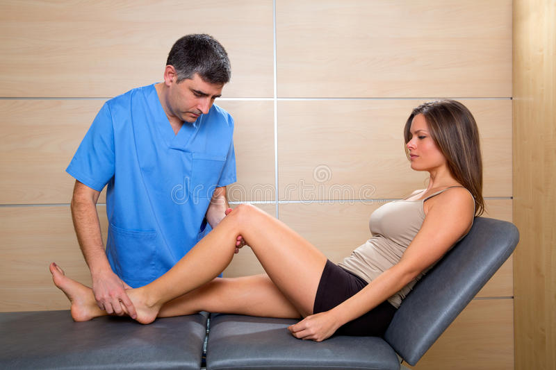 Knee examination doctor to woman patient stock photo