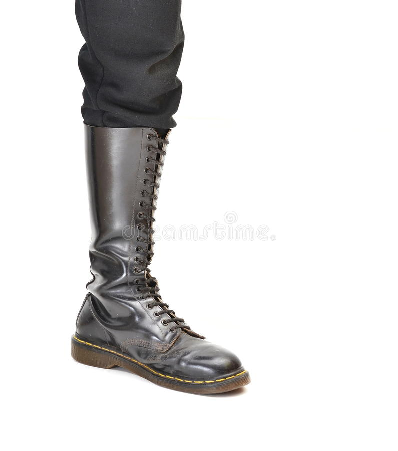 Knee-high 20 eyelet black lace-up boot stock photography
