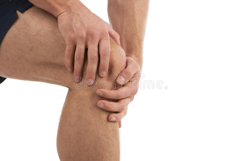 Knee Pain. A male jogger with sudden knee-pain