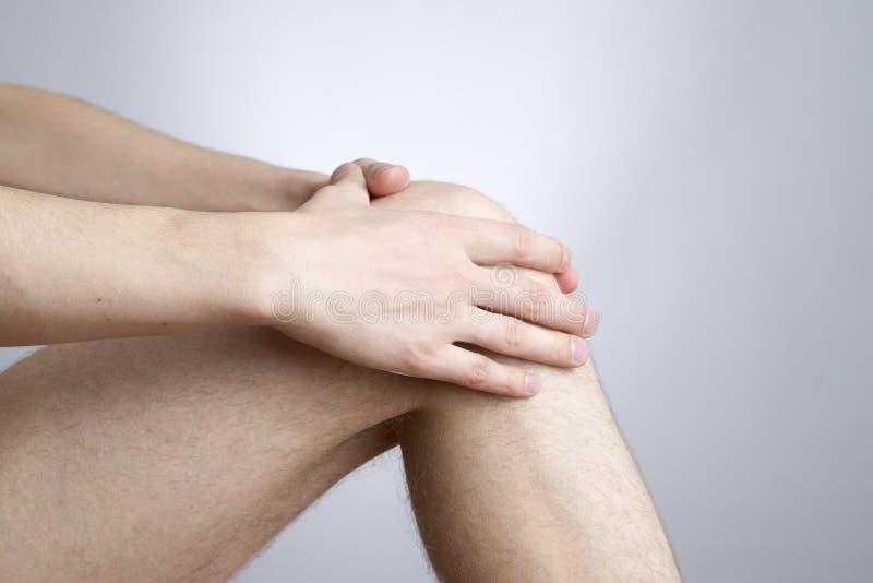 Knee pain in men royalty free stock photo