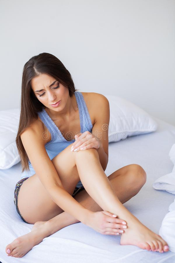 Knee Pain. Unhappy Woman Suffering From Pain in Leg at Home stock photos