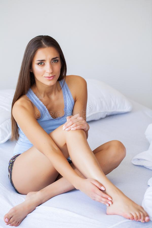 Knee Pain. Unhappy Woman Suffering From Pain in Leg at Home royalty free stock images