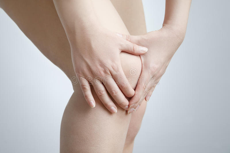 Knee pain of the woman royalty free stock images
