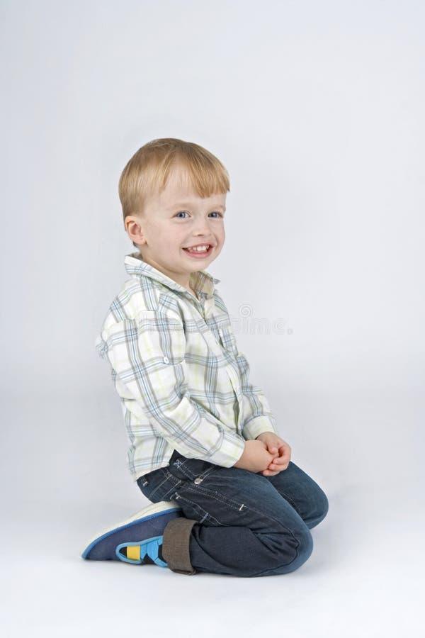 Kneeler boy. stock photography