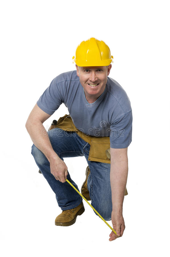 Kneeling Construction Worker Smiles Royalty Free Stock Photography