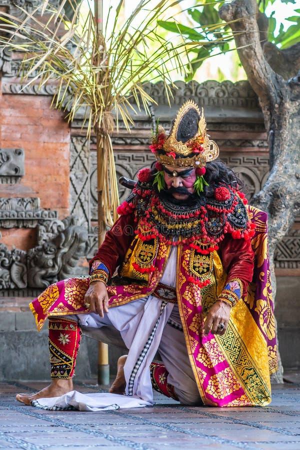 Kneeling King at Sahadewa Barong Dance Studio in Banjar Gelulung, Bali Indonesia. Banjar Gelulung, Bali, Indonesia - February 26, 2019: Mas Village. Play on royalty free stock images
